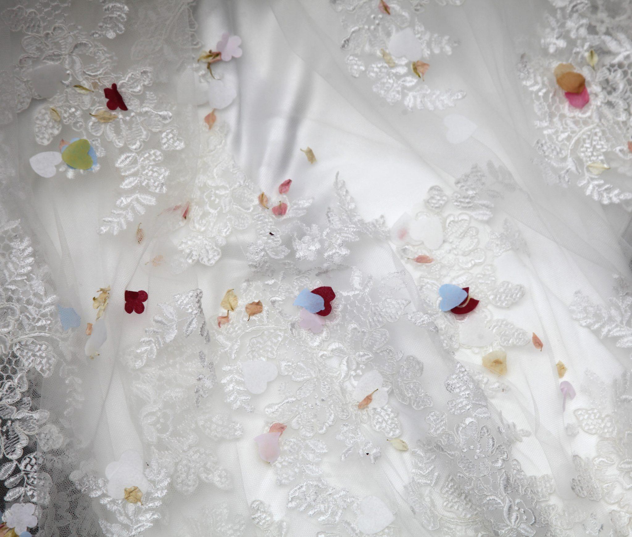 Confetti on wedding dress