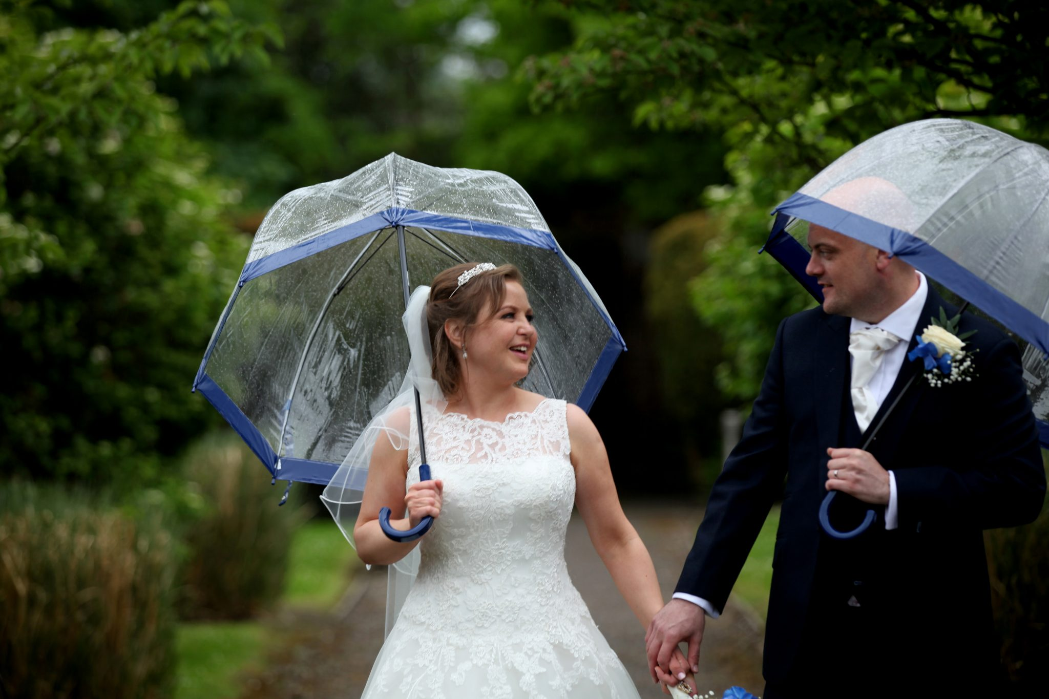Bride and Groom in rain at Latimer Place