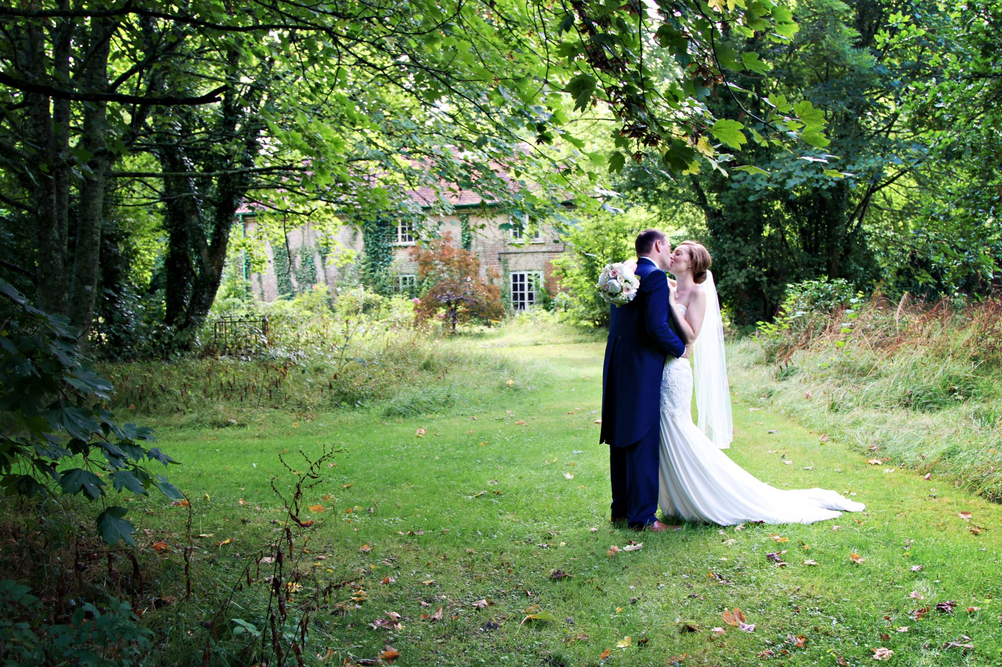Bride and Groom in grounds at Eastclose Hotel, Hampshire.