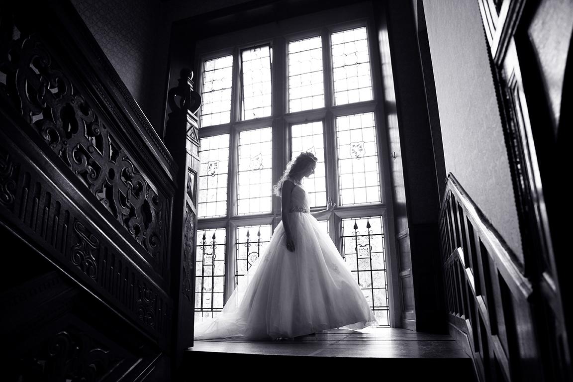 Bride on staircase at Hanbury Manor