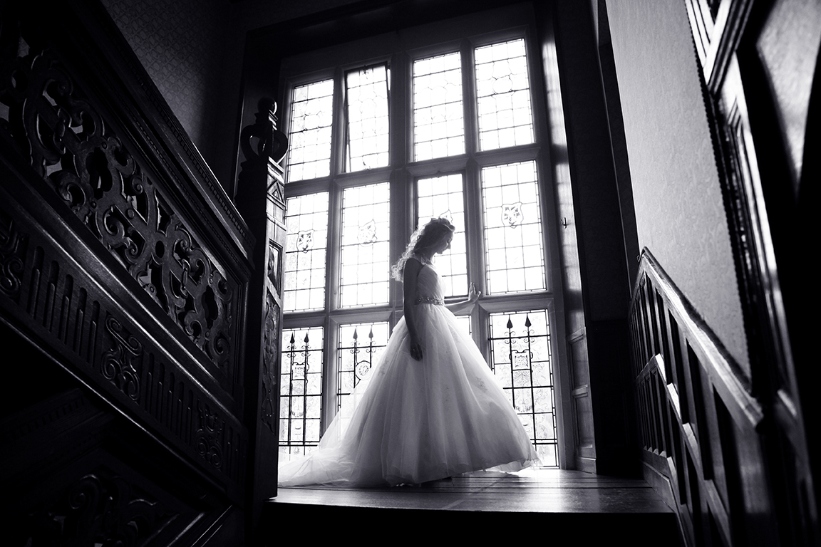 Bride on staircase at Hanbury Manor