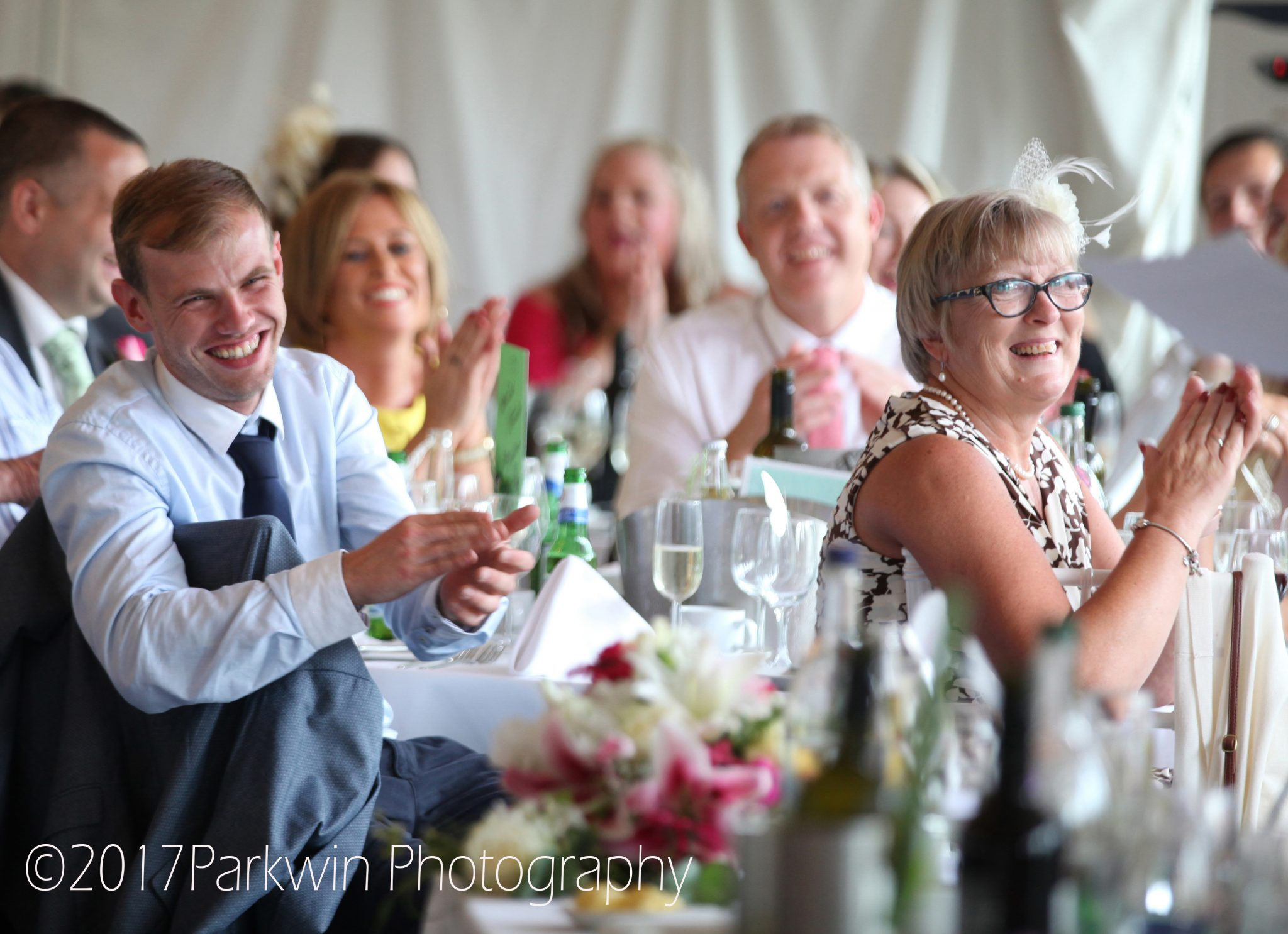 Guests listening to speeches at Hunton Park wedding