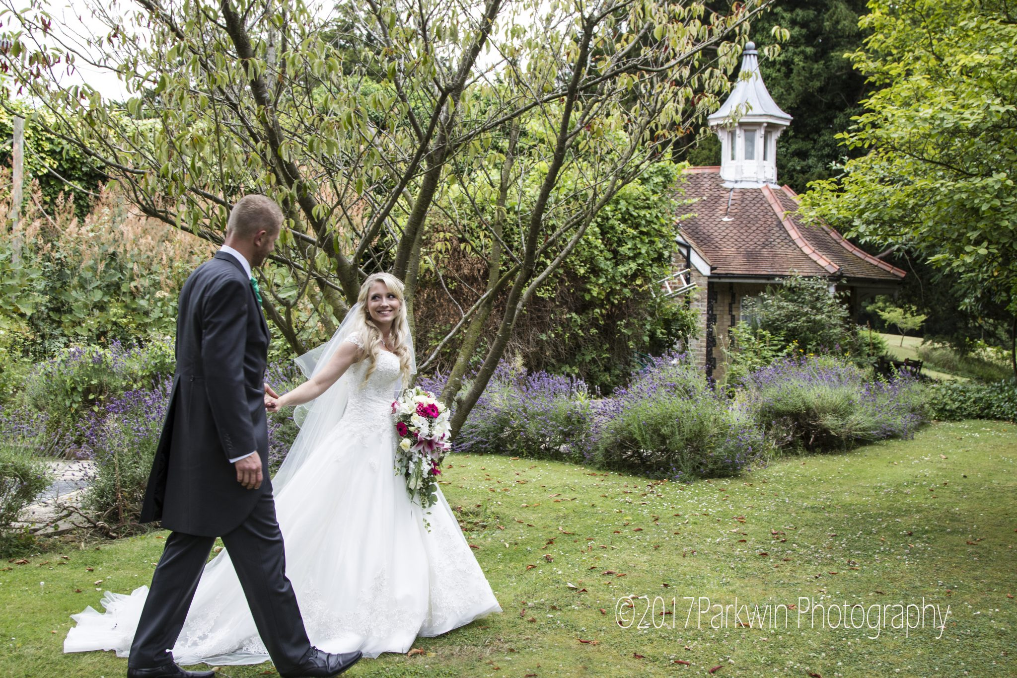 Bride and groom in Lavender Garden at Hunton Park