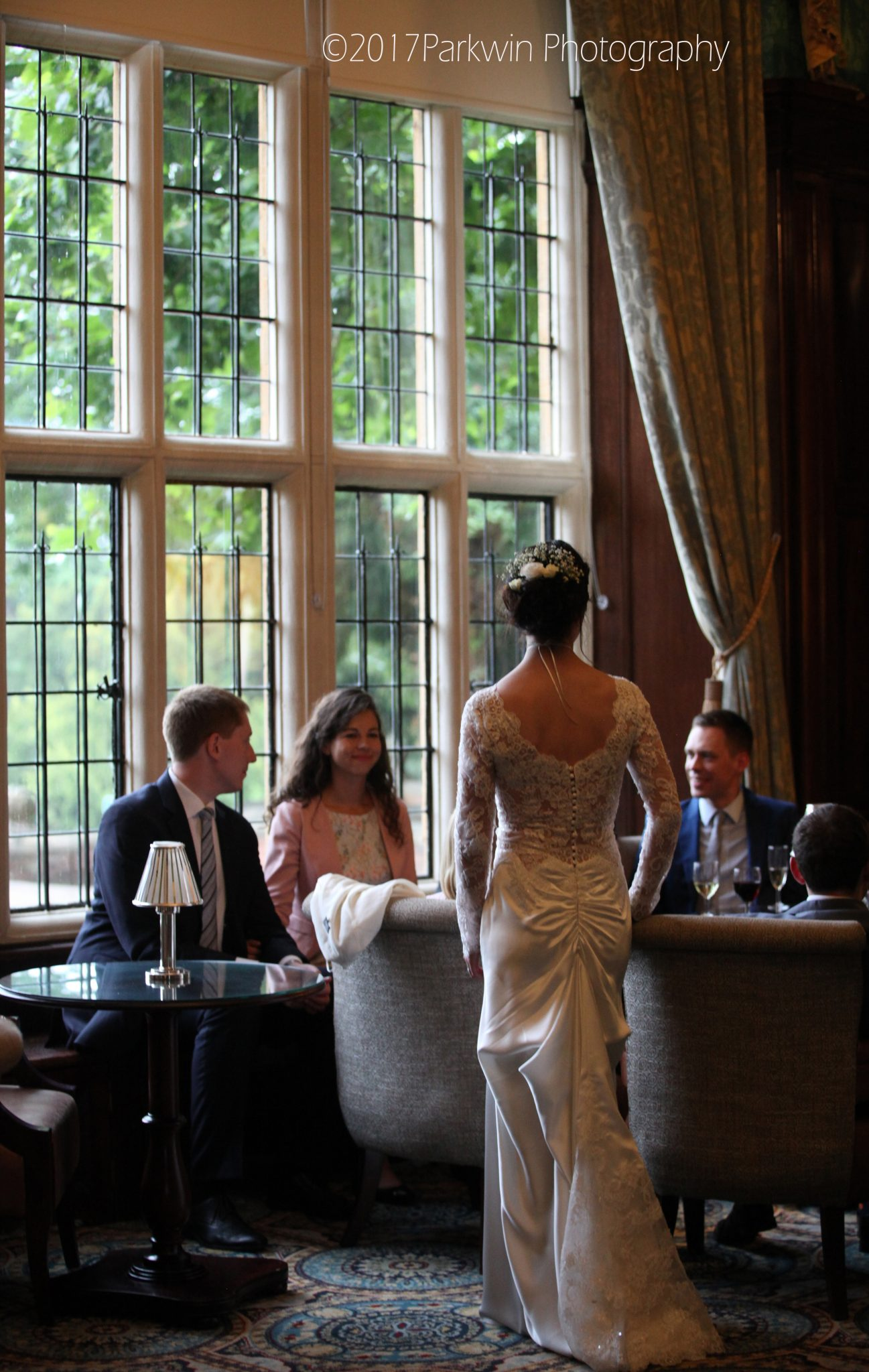 bride talking to guests at Hanbury Manor