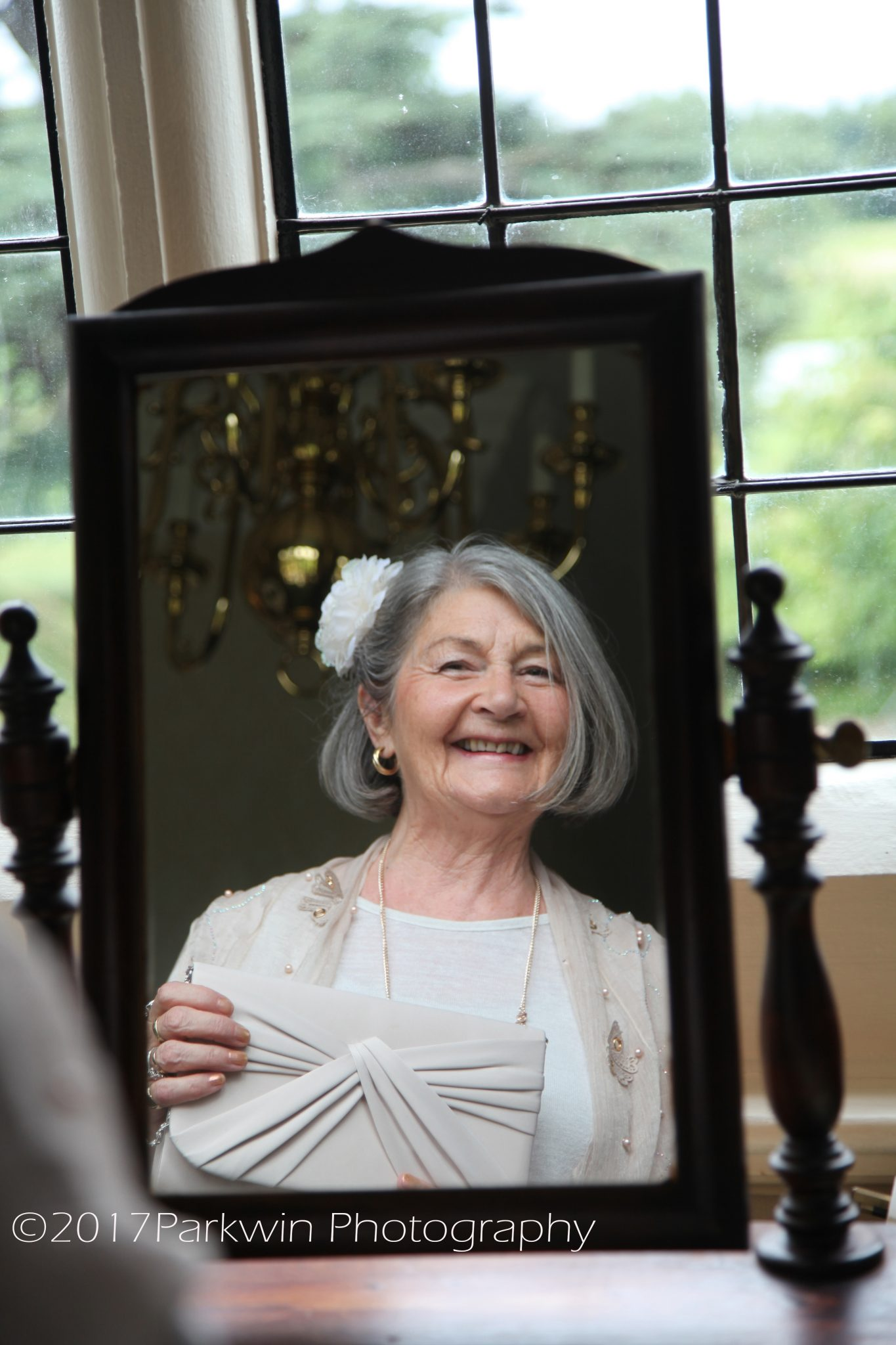 Grandma looking in mirror at Hanbury Manor
